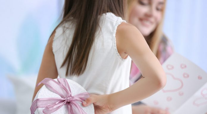 A daughter giving a gift to her mother