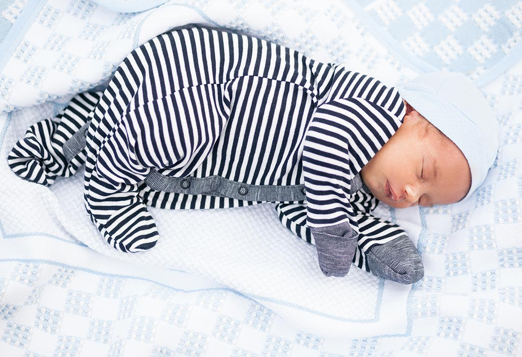 A Baby Sleeping On One Side