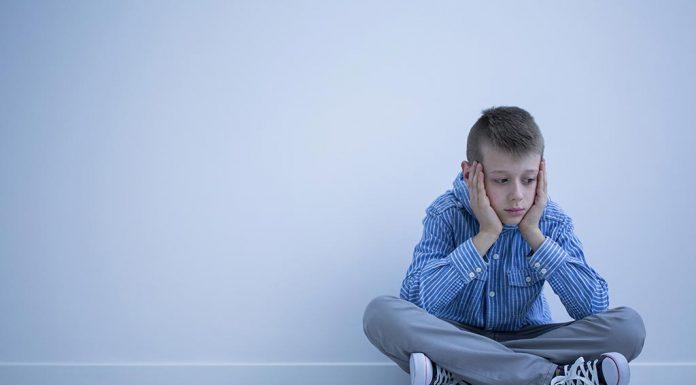 A boy sitting alone