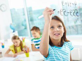A little girl solving a maths sum
