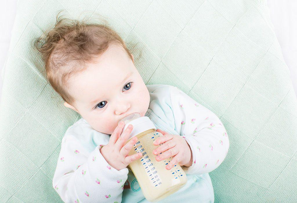 A baby drinking formula milk