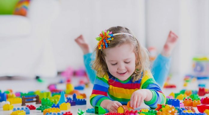 Preschooler playing with colourful blocks