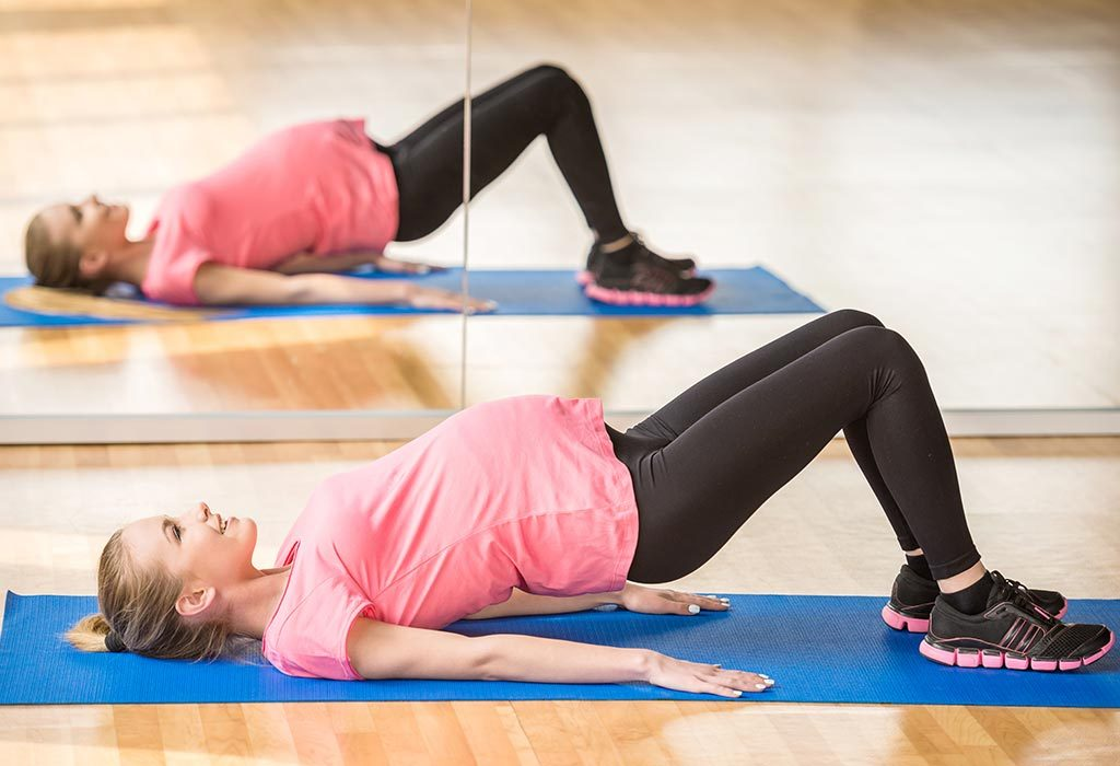 A pregnant woman doing kegel exercise