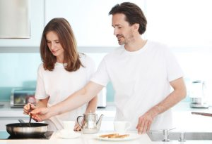 Husband and wife cook together