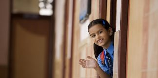 A little girl dressed in her school uniform
