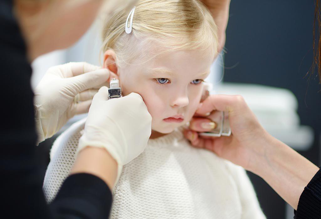 Girl getting ear pierced