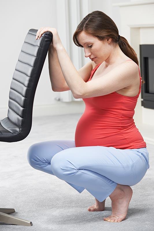 A pregnant woman performing squats