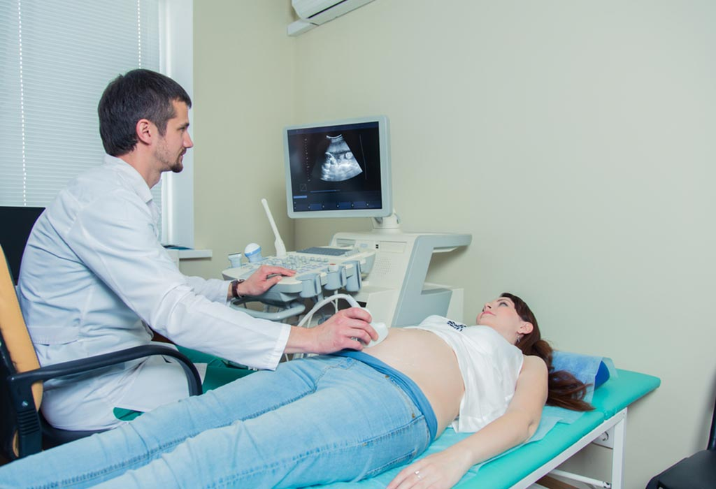 16 weeks pregnant woman getting ultrasound