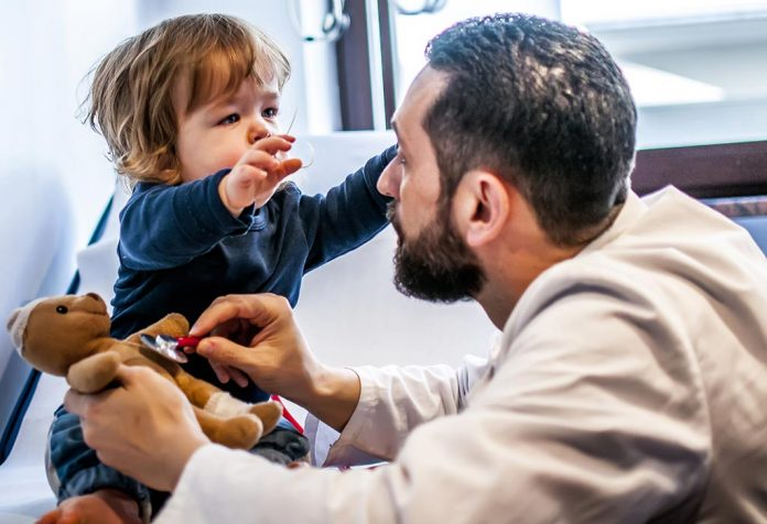 A doctor examining a child for dwarfism