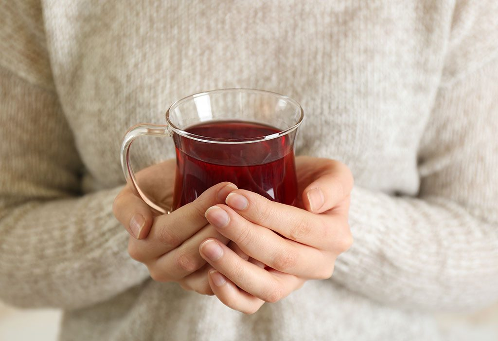 A woman drinking black tea