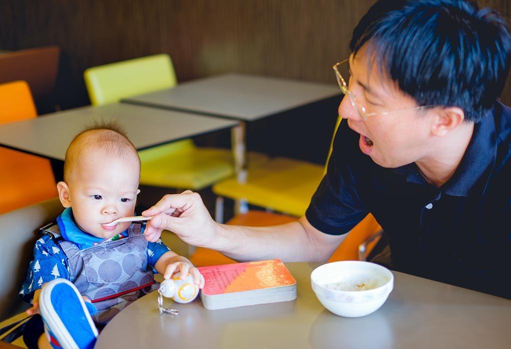 A baby eating suji porridge
