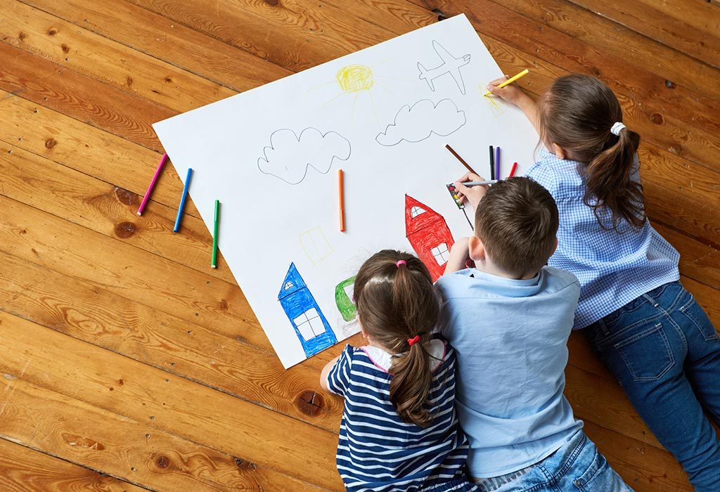 Three kids drawing together