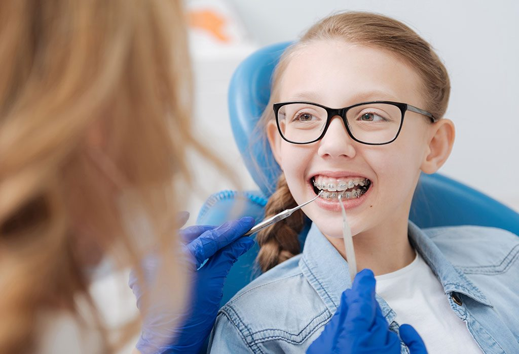 A child getting braces at dentist's place