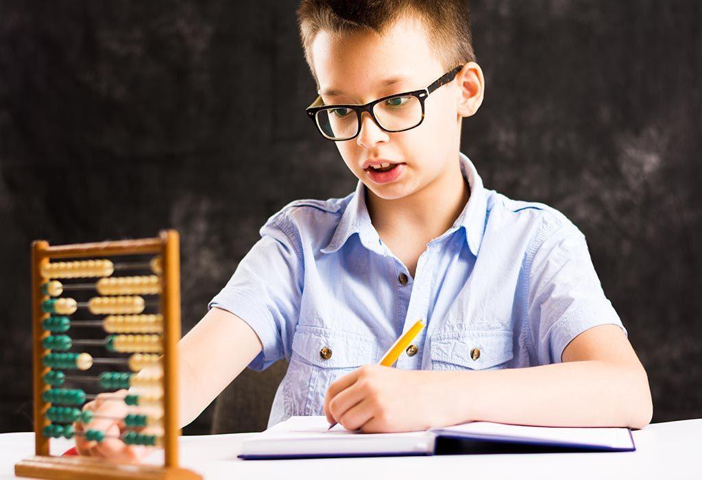 A boy solving maths problems