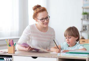 A woman teaching a girl with dyslexia