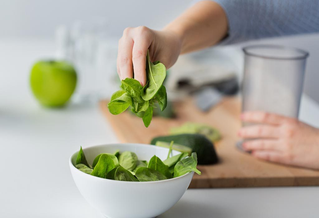 Woman making spinach smoothie