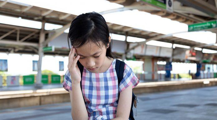 A little girl feeling dizzy