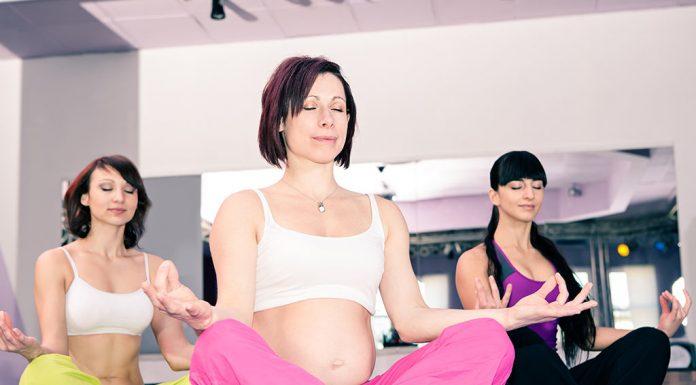 A pregnant woman doing aerobics