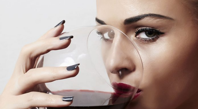 A woman drinking a glass of wine