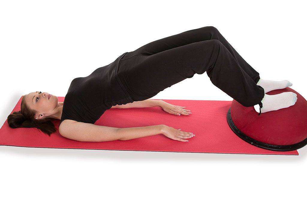 A woman doing pelvic exercises.
