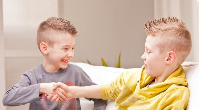 Two children shaking hands