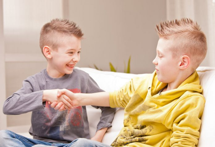 Two children shaking hands