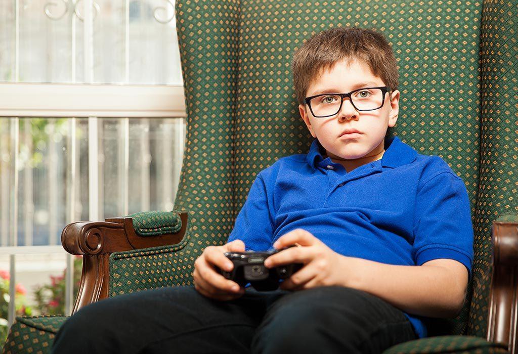 A sad boy playing video games