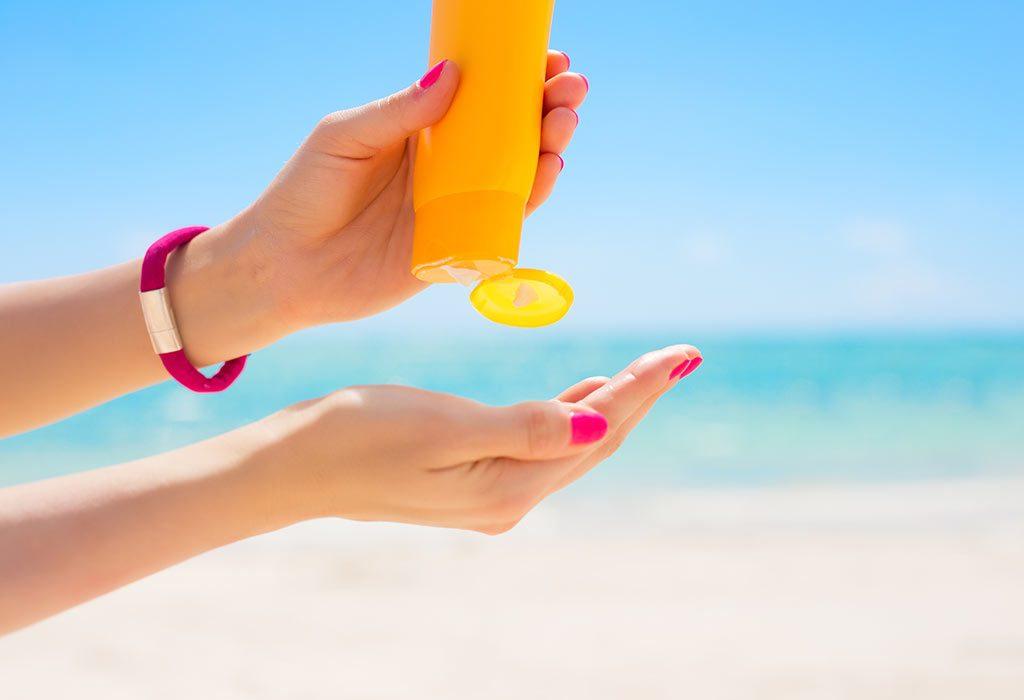 A woman using a sunscreen