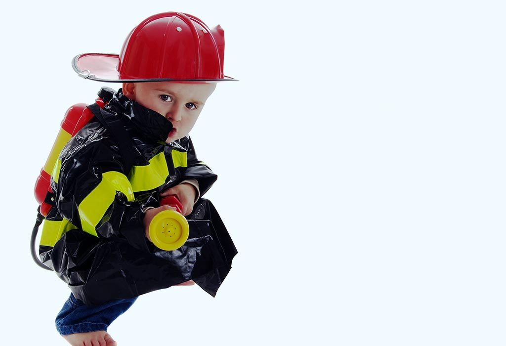 A toddler in a fire fighter's costume