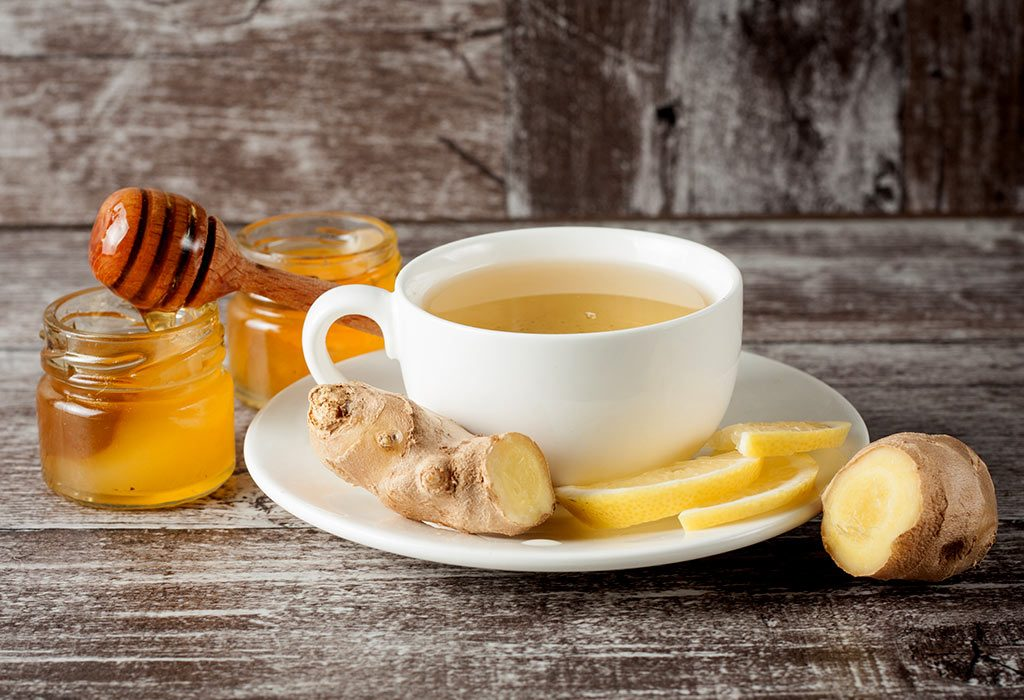A cup of ginger tea with honey and lemon