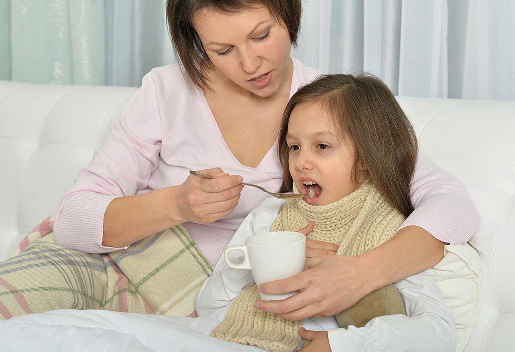 A mother taking care of her unwell daughter
