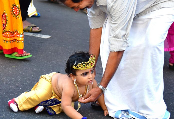 A baby dressed as Lord Krishna