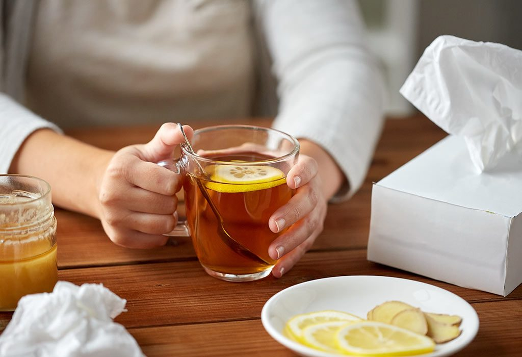 A woman drinking ginger tea