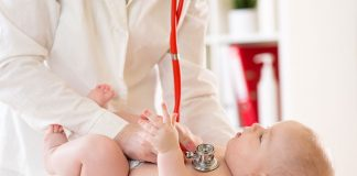 A doctor examining an infant