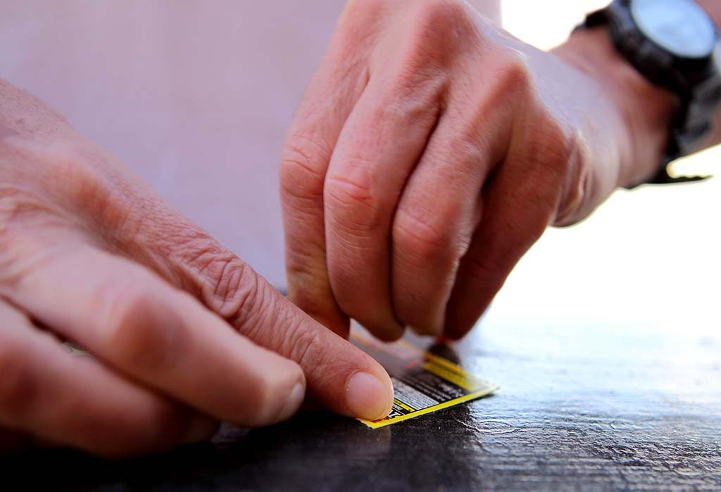 A father using a scratch card