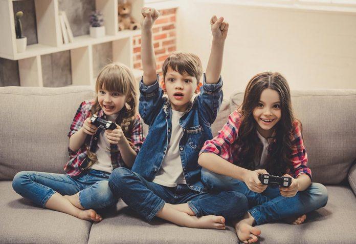 Three kids playing video games