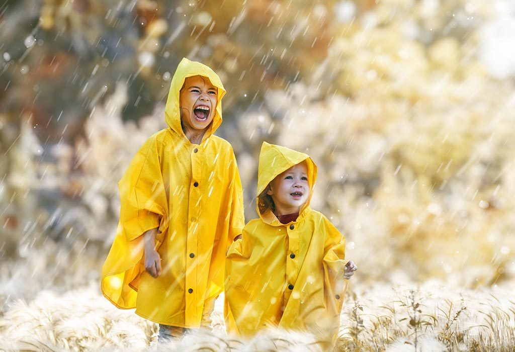 Two little girls in yellow raincoats