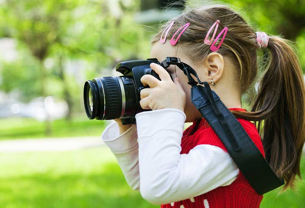 A GIRL TAKING PICTURES