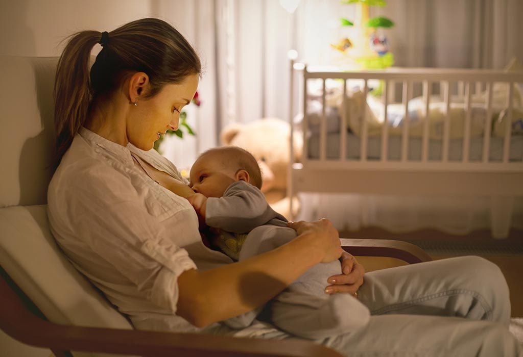 Mom breastfeeds her baby