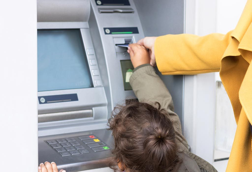 Little girl at the ATM