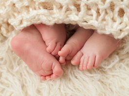Feet of newborn twins