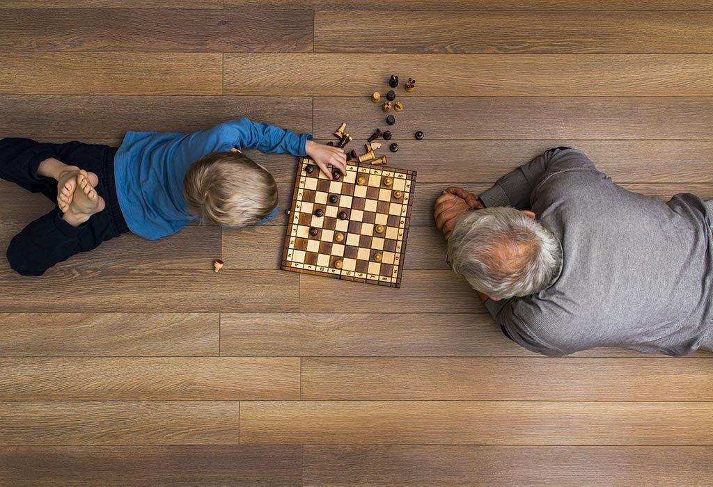 Grandfather teaching chess
