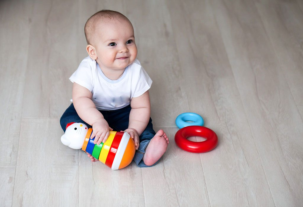 A baby holding a toy