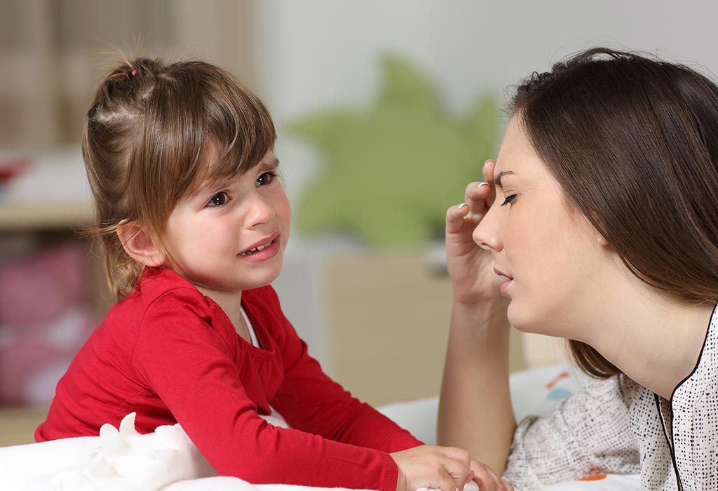 Fed-up mother with cranky toddler