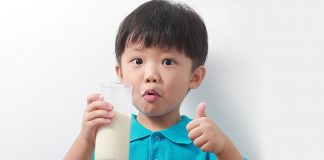 A little boy drinking milk