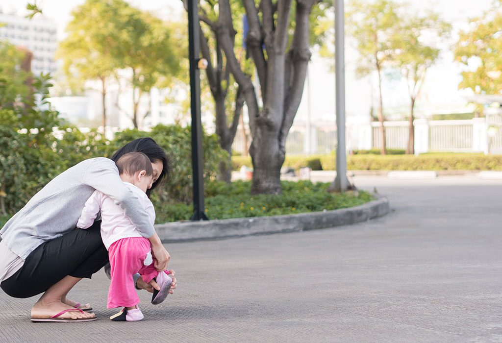 Baby wearing shoes while walking