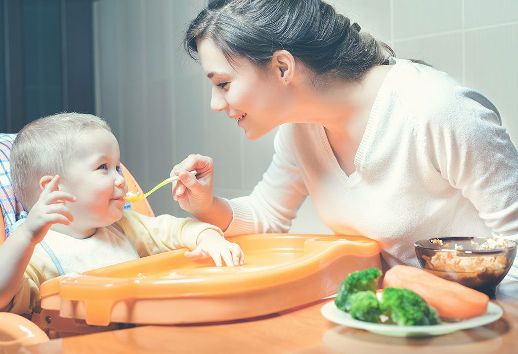 Mom feeds baby healthy food