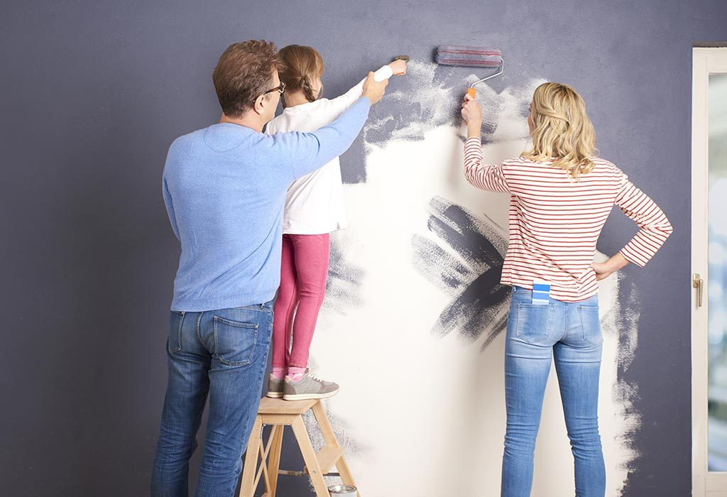 Mom and child painting wall