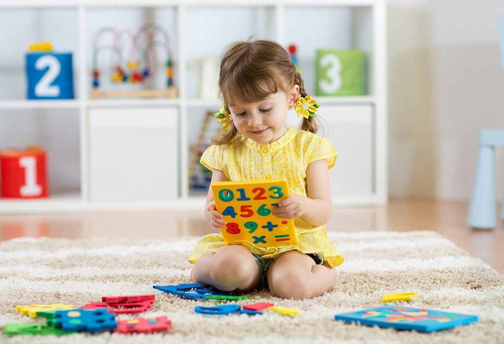 Little girl playing with digits
