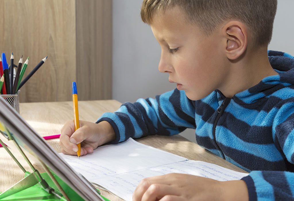 A boy practices cursive writing